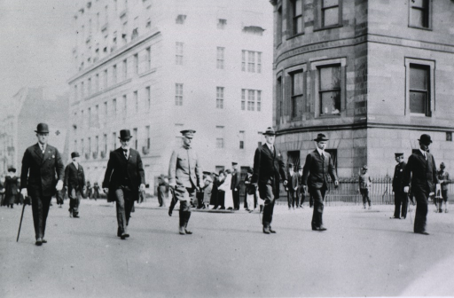 <p>Full length, marching in line with President Wilson (to the right).</p>
