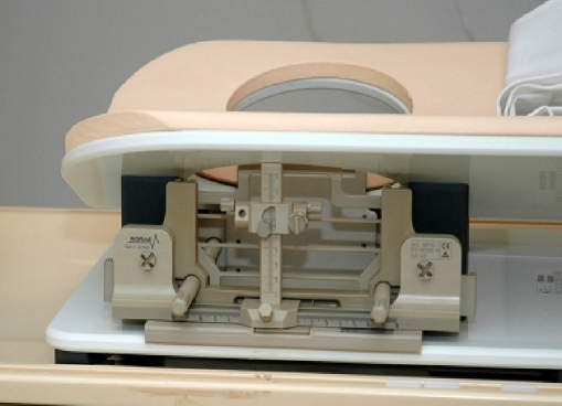 Stereotactic system for MRI-guided preoperative wire-localization and breast biopsy. This system consists of a breast coil, which can be used for diagnostic MRI of the breast, and an add-on stereotactic device. The breast is compressed by two compression plates. The system allows angulation of the needle