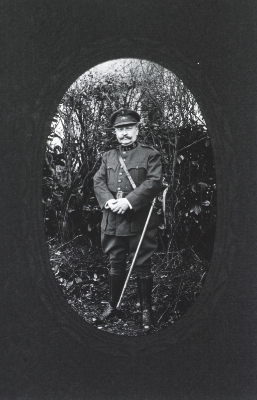 <p>Standing, full length pose; front; in Belgian uniform; hands clasped; wearing cap and sword.</p>