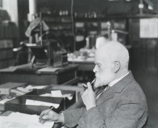 <p>Prof. A.D. Waller at his desk in the Physiological Laboratory, Imperial Institute, London, writing up some experiments on the physiology of plant growth.</p>