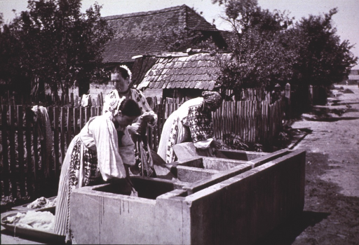 <p>Three women washing clothes at troughs in the open in Mraklin, Yugoslavia.  One of a collection of pictures from 1928 depicting the early Public Health Organization.</p>