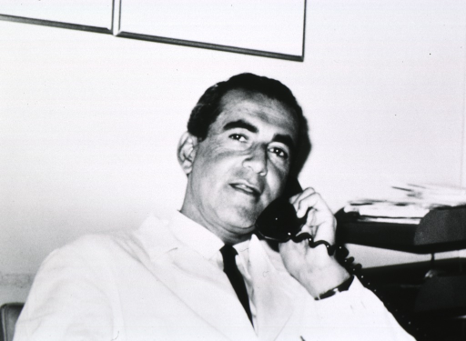 <p>Head and shoulders, seated, full face; using the telephone.</p>