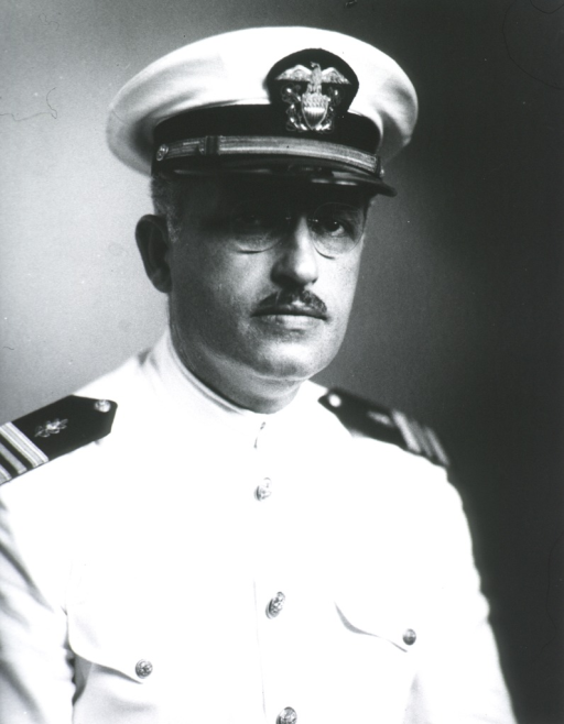 <p>Head and shoulders, full face, wearing white U.S. Navy uniform and cap of Lt. Commander, Med. Corps.</p>