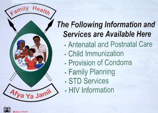 <p>White poster with multicolor lettering.  Title on left side of poster, as part of visual image.  Image is an illustration of a shield in front of two crossed spears with English text above and Swahili text below.  Center of shield features an illustration of a five-member family.  Text listing services available from a health center dominates right side of poster.  List includes prenatal and postnatal care, child immunizations, family planning and condom distribution, STD services, and HIV information.  Publisher information in lower left corner.   Poster is on adhesive paper.</p>