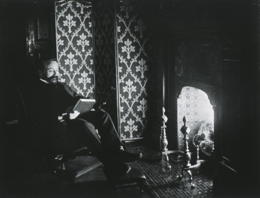 <p>Full length, seated before fireplace, right pose, reading book.</p>