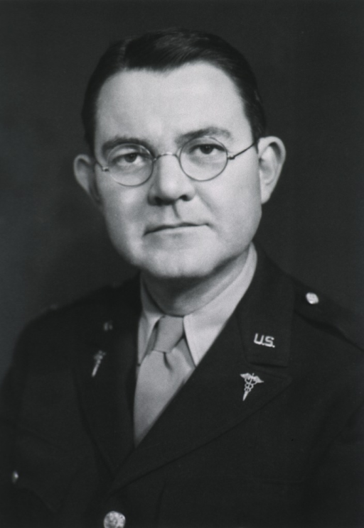 <p>Head and shoulders, full face, glasses; uniform, M.C.</p>