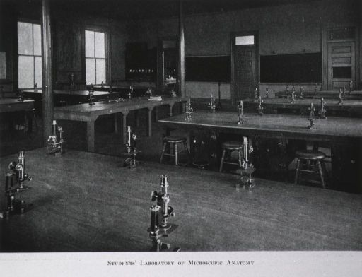 <p>Interior view: there are stools and seven lab tables with microscopes.  This is a partial view of the laboratory that is supplied with high grade microscopes, dissecting microscopes, camera lucida, and other apparatus and materials.</p>