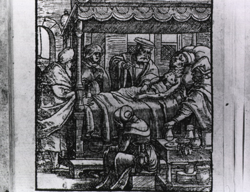 <p>Doctor at bedside, taking a pulse.</p>