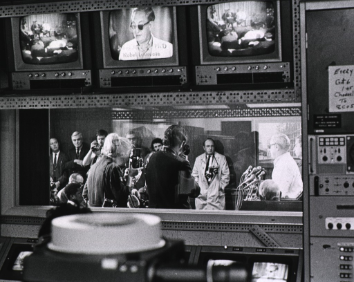 <p>Showing Dr. Axelrod meeting with the news media.</p>