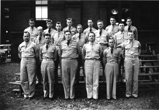 <p>Colonel Joseph H. McNinch stands alongside Major Frank B. Rogers with a detachment of 15 enlisted men in front of the Army Medical Library.</p>