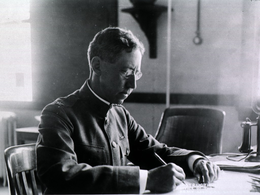 <p>Seated at desk, right profile, writing, wearing uniform (Colonel).</p>