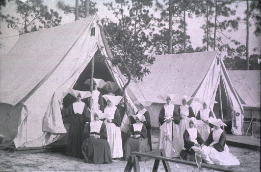 <p>View of nursing nuns seated in front of tents (the U.S. Army 3rd Division Hospital, 7th Army Corps).</p>