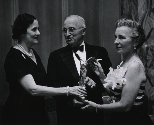 <p>All half-length; Lasker, right profile; Truman, front pose, head turned to left, wearing glasses; Leone, left profile.  Lasker and Truman presenting award to Leone.</p>