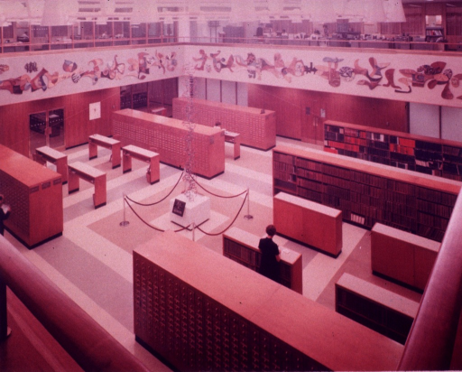 <p>Interior view: A.A. Barker's 15 foot double-stranded Helix DNA model is suspended from the ceiling of the card catalog area.  This exhibit is centered on the work of the Nobel Laureate Marshall W. Nirenberg.</p>