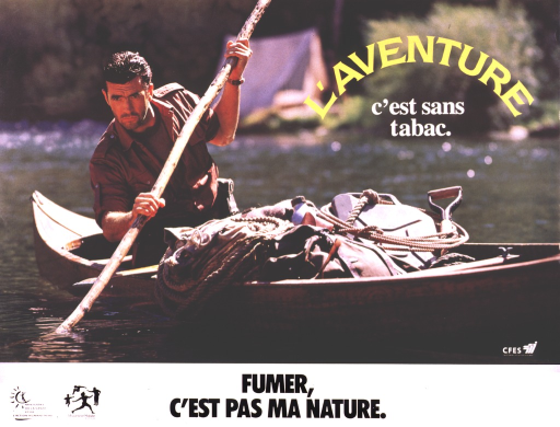 <p>A man is paddling a rustic canoe, the visible part of the paddle being a tree limb.  A tent is out of focus but visible on the shoreline.  He has a rope, shovel, and camping gear in the canoe with him.</p>