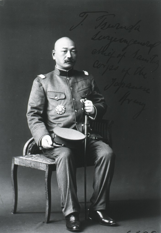 <p>Seated, full length picture, front pose, in uniform.</p>