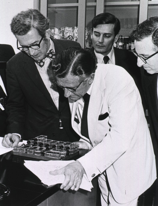 <p>Rep. L.H. Fountain; Dr. David P. Rall, NIEHS Director; Mr. William Alexander; and Dr. D.C. Goldberg, Professional Staff Member of the Subcommittee; examine tissue cultures used by NIEHS scientists in mutagenesis research.</p>