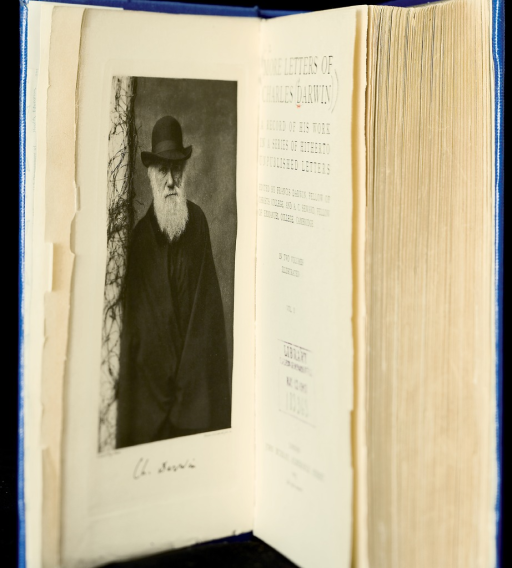 <p>Image of the frontispiece portrait of Charles Darwin and title page from v. 2 of Darwin's More letters of Charles Darwin, 1903. The portrait shows Darwin in a long white beard, wearing a dark cape and brimmed hat.</p>
